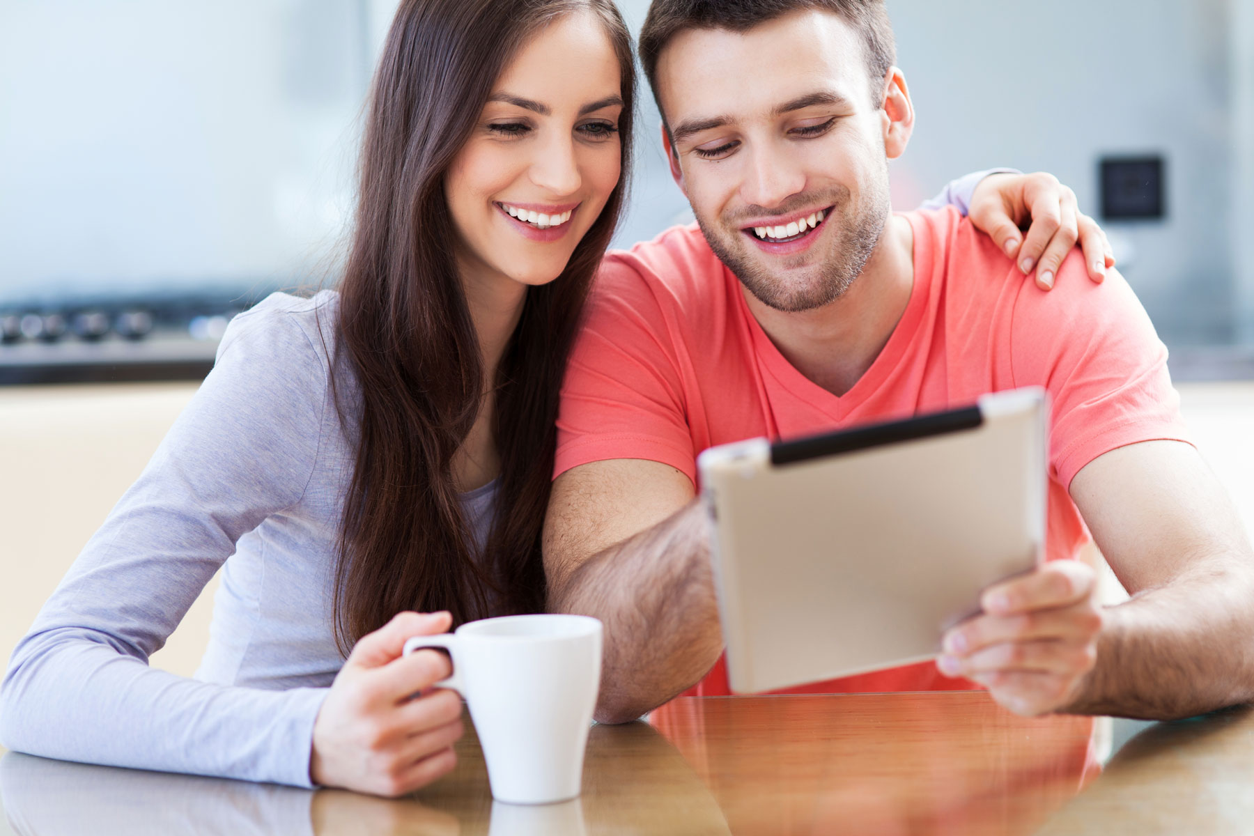 couple-looking-at-ipad-x1800.jpg